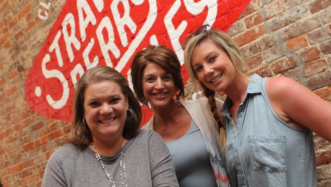 Sally Lee, Tina Augustine and Carrie Britt at the Strawberry Alley Ale Works Preview Party Saturday. The new restaurant/bar/brewery officially opens for business April 2.