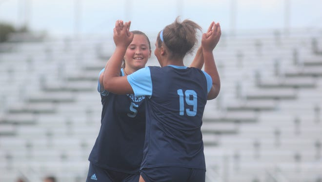 Boone County senior Rielyn Hamilton, 19, celebrates with sophomore Raygen Black, 5, after Black scored a goal in the first half during Boone County's 5-1 win over Richmond Model in girls soccer Sept. 15, 2018 at Boone County HS, Florence KY. Rielyn Hamilton, an Akron commit, scored twice to set the new BCHS scoring record at 104 goals. during Boone County's 5-1 win over Richmond Model in girls soccer Sept. 15, 2018 at Boone County HS, Florence KY. Rielyn Hamilton, an Akron commit, scored twice to set the new BCHS scoring record at 104 goals. during Boone County's 5-1 win over Richmond Model in girls soccer Sept. 15, 2018 at Boone County HS, Florence KY. Rielyn Hamilton, an Akron commit, scored twice to set the new BCHS scoring record at 104 goals.