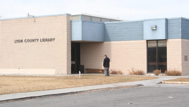 A visitor stands near the Lyon County Central Branch Library in Yerington. The library system recently received a $2,818 collection development grant from the Nevada State Library and Archives to be used for the system's collections for e-books in the coming year.