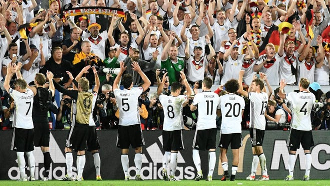 From left: Germany's midfielder Bastian Schweinsteiger, Manuel Neuer, Mats Hummels, Mesut Oezil, Julian Draxler, Leroy Sane and Benedikt Hoewedes, acknowledge the crowd after Germany won the match in the Euro 2016 quarterfinals on July 2 in Bordeaux.