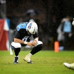 Tennessee Titans quarterback Marcus Mariota is on the ground after being sacked by Cleveland Browns defensive lineman Jamie Meder (98).