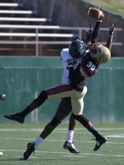 Midwestern State's Jaydon Cunigan breaks up the pass to Eastern New Mexico's Aaron Johnson Saturday, Nov. 12, 2016, in Memorial Stadium. The Mustangs lost 30-28 on the final play to the Greyhounds.