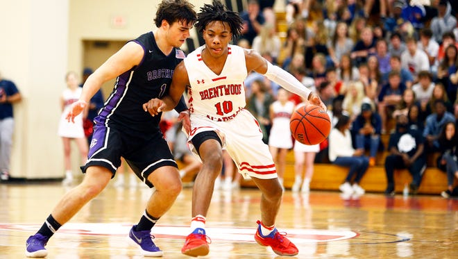 Brentwood Academy's Darius Garland (10) brings the ball up court as he's defended by Christian Brothers' Zach Hamlet (1) during their Division II-AA game, Saturday, Feb. 24, 2018, in Nashville, TN. (Photo by Wade Payne, Special to the Tennessean)