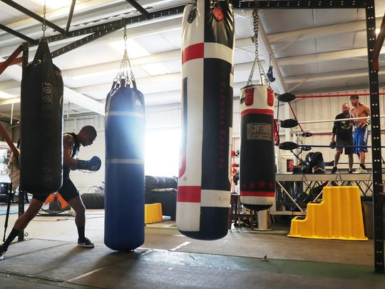 Bryant Perrella, right, 15-1 trains with his head trainer Mike Nowling at Syndicate Boxing Club in south Fort Myers on Monday. He is fighting former welterweight champion Luis Collazo, 37-7 (20 KO's), August 4 at the Nassau Coliseum in Uniondale, NY.
