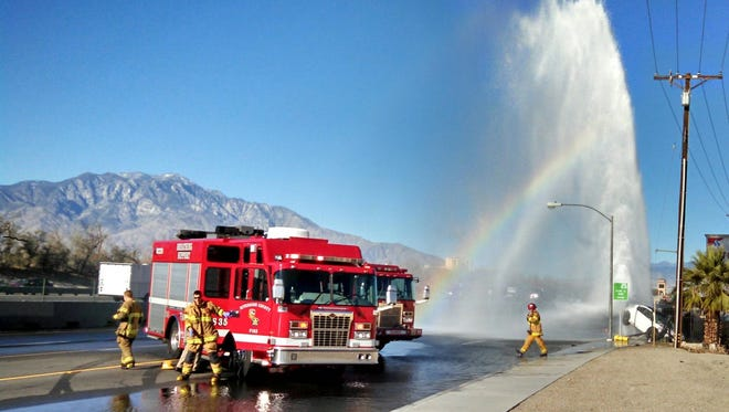 An overturned car struck a fire hydrant in Thousand Palms Tuesday. It shut down lanes on Varner Road.