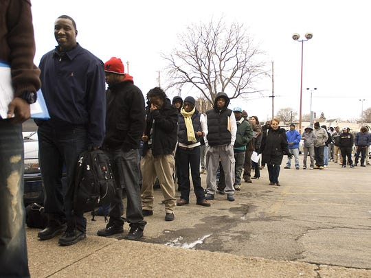 People lining up in 2012 to apply for job training in Phase 1 of the Rochester school modernization program.