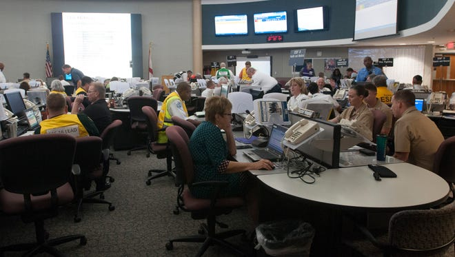 Officials gather on Wednesday, May 3, 2017, at the Emergency Operation Center on W Street for the annual hurricane preparedness drill.