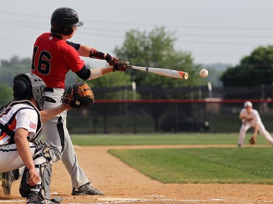 Hempfield's Ben Lukawski (16) brings in a run with this sacrifice hit against Hershey during 1st inning action at Hempfield High School Monday May 18, 2015. Chris Knight - GametimePa.com