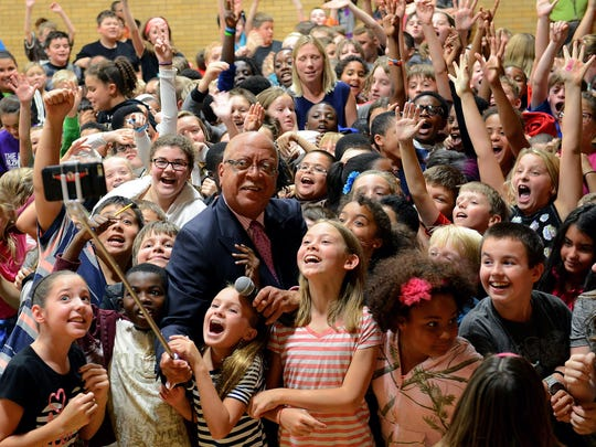 Ingham County Judge Hugh Clarke Jr., takes a selfie Sept. 25 with fifth- and sixth-grade students at Hope Middle School in Holt. Clarke was speaking to them about the nationwide HistoryMakers project.