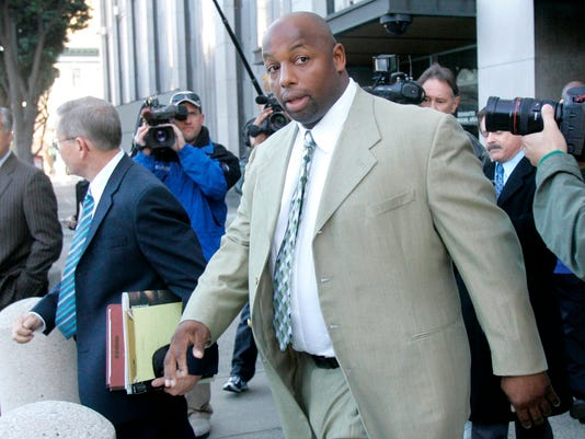 """File - In this Jan. 18, 2008 file photo, former NFL football player Dana Stubblefield leaves a federal courthouse in San Francisco. Prosecutors say they have charged former San Francisco 49er Dana Stubblefield with the rape of a """"developmentally delayed"""" woman. The Santa Clara County District Attorney's Office says the 45-year-old Stubblefield was charged Monday, May 2, 2016, with sexually assaulting the woman last year at his Morgan Hill home. (AP Photo/Jeff Chiu, File)"""