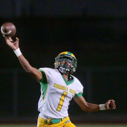 Coachella Valley quarterback Armando Deniz throws against