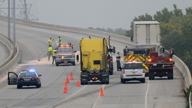 Workers clean up a fuel spill following a crash on I-43 in Green Bay, Thursday, Oct. 2, 2014.