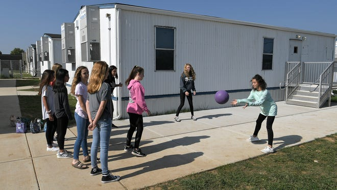 Page Middle School eight graders play during recess near new eight portable classrooms that  the school had to add this year due to the increase of new students to the Franklin school.