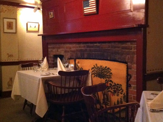 Antique furniture, brick fireplaces and checked curtains