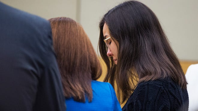 Jodi Arias, right, reacts as the jury leaves the courtroom after announcing the verdict in the sentencing phase of her retrial on Thursday, March 5, 2015, in Maricopa County Superior Court in Phoenix.