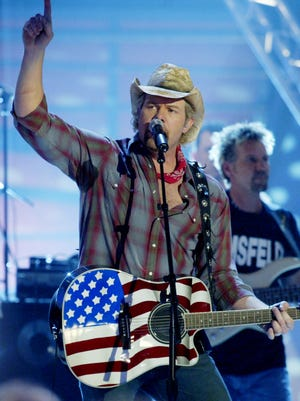 Toby Keith won the Academy of Country Music's Entertainer of the Year award in 2002 and 2003. Here, he performs at the CMT Flameworthy Video Music Awards show in 2003.