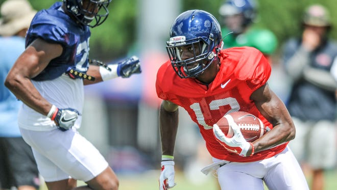Wide receiver Van Jefferson runs with the ball during preseason camp. The redshirt freshman is looking to make a big impact after sitting out last year.