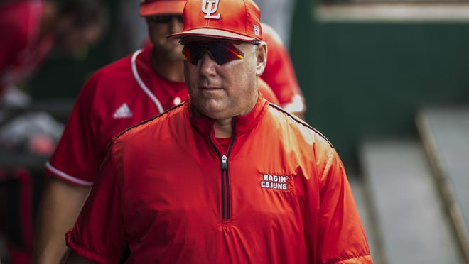UL head coach Tony Robichaux walks in the dugout during an NCAA regional game against Rice on May 29.
