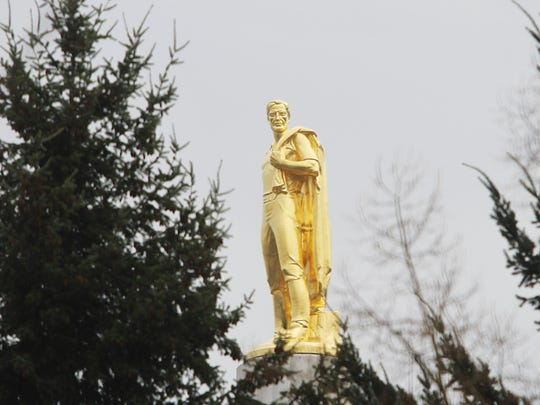 "The Oregon Pioneer, or ""Gold Man,"" stands atop the Oregon Capitol."