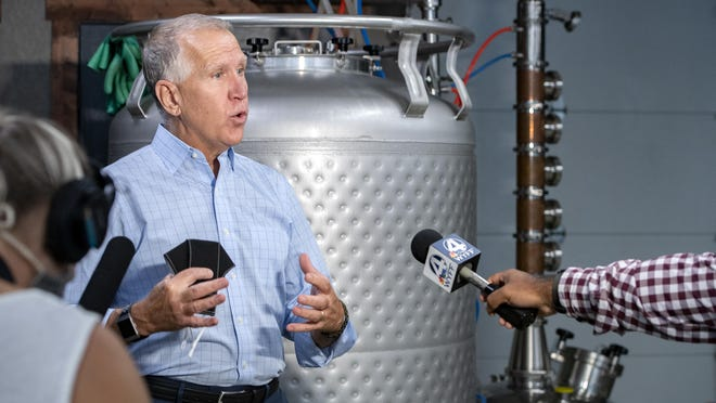 U.S. Sen. Thom Tillis talks with members of the media after a roundtable discussion with the owners of Cultivated Cocktails Distillery at the Buncombe County distillery on Aug. 26.