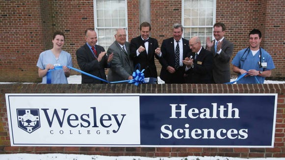About 150 people, including Wesley College President William N. Johnston and Gov. Jack Markell, attended a ribbon-cutting event on March 6 to celebrate the opening of a renovated and expanded health sciences building.