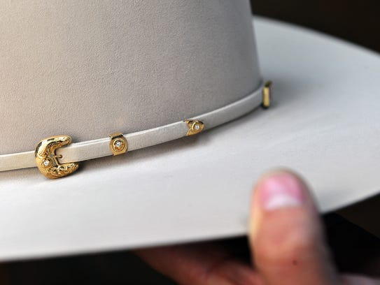 Special gold and diamond hardware adorn the trim on