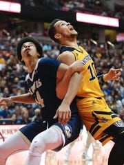 UC Davis' Garrison Goode, left, and UC Irvine's Luke Nelson fight for position during the first half of an NCAA college basketball game for the championship of the Big West tournament Saturday, March 11, 2017, in Anaheim, Calif.