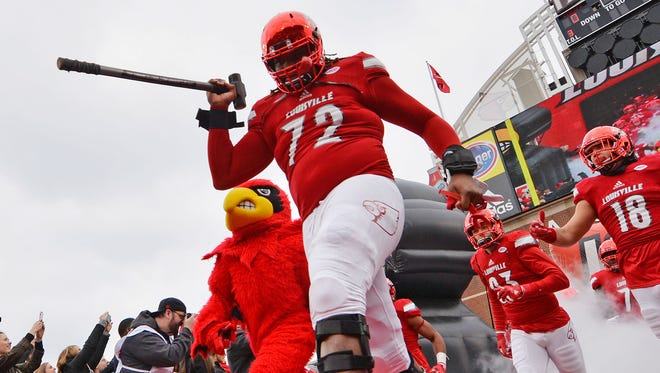 Nov 26, 2016; Louisville, KY, USA;  Louisville Cardinals offensive lineman Lukayus McNeil (72) leads the team to the field before the first half against the Kentucky Wildcats at Papa John's Cardinal Stadium. Kentucky defeated Louisville 41-38.  Mandatory Credit: Jamie Rhodes-USA TODAY Sports