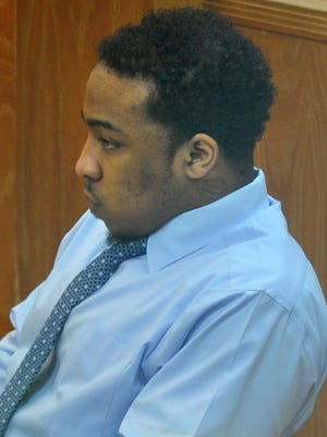 Willie Maurice Hervey Jr. listened as an expert witness testified during Hervey's murder trial Friday afternoon.