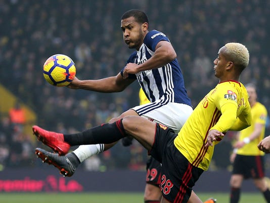 West Bromwich Albion's Salomon Rondon, left, and Watford's Andre Carrillo in action during their English Premier League soccer match at Vicarage Road in Watford, England, Saturday March 3, 2018. (Mark Kerton/PA via AP)