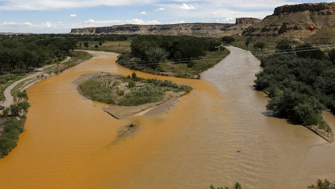 The confluence of the San Juan River is pictured Aug. 8 after the Gold King Mine spill. At left is the contaminated Animas River, and at right is the San Juan River.