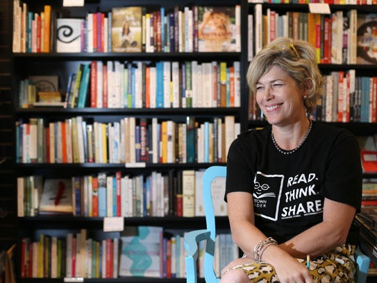 Sally Bradshaw, owner of Midtown Reader, sits in her