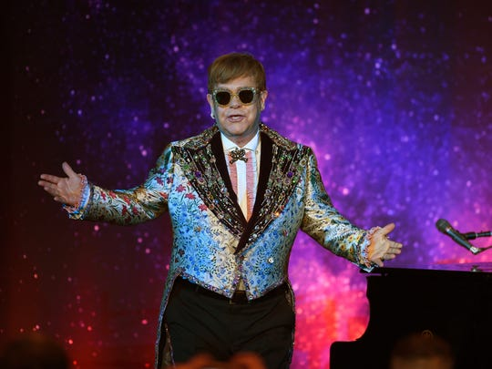 Elton John performs two songs before a press conference in New York Jan. 24, 2018.