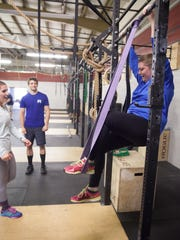 Haley Dover, Free Press reporter, does crossfit excersizes in Colchester, Friday. KEVIN HURLEY/for the FREE PRESS