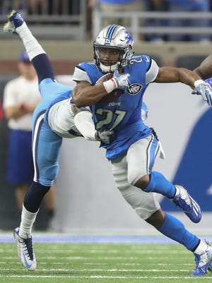 Detroit Lions running back Ameer Abdullah runs the ball against the Tennessee Titans during the second quarter Sunday, Sept. 18, 2016 at Ford Field in Detroit.