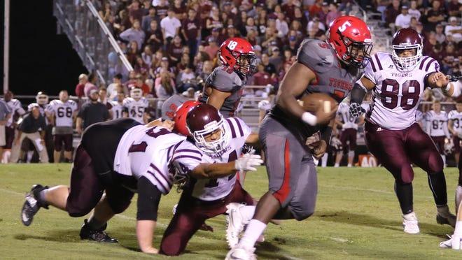 Hardin County's Joey Burd (14) tries to tackle Lexington's Tylan Johnson (5) on Friday.