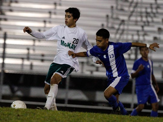 McKay's Jorge Garibay, left, battles for the ball.