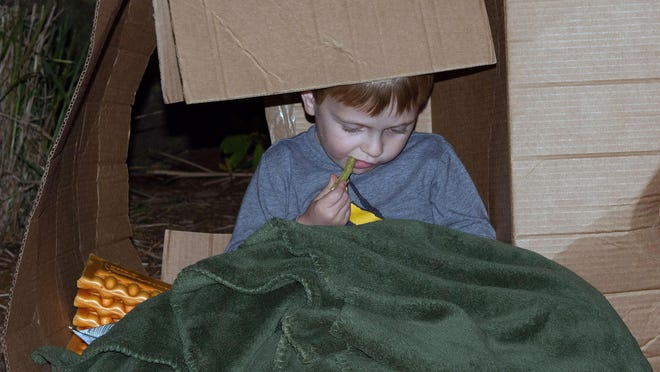 Ryker Govern of Edneyville makes himself comfortable during the ninth annual Sleepout to benefit Only Hope WNC, a not-for-profit agency that helps homeless youth.