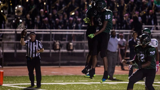 October 7, 2016 - Cordova's Edward Johnson, 3, celebrates with his teammate Isiah Stinson, 16, after scoring a touchdown during the first half of Friday night's game between Cordova and White Station.