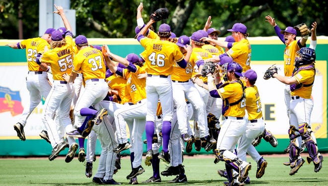 LSU players celebrate after defeating UNC-Wilmington 2-0 Monday afternoon to advance to this weekend's Super Regional in Baton Rouge.