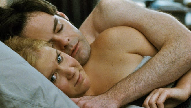 """Amy Schumer (foreground) and Bill Hader star in """"Trainwreck,"""" which has grossed $66 million as of July 28."""