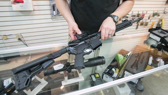 Assault weapon on sale at a Valley gun shop