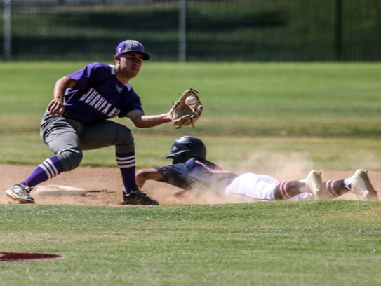 La Quinta's Miles Dille is safe on 2nd as ball reach