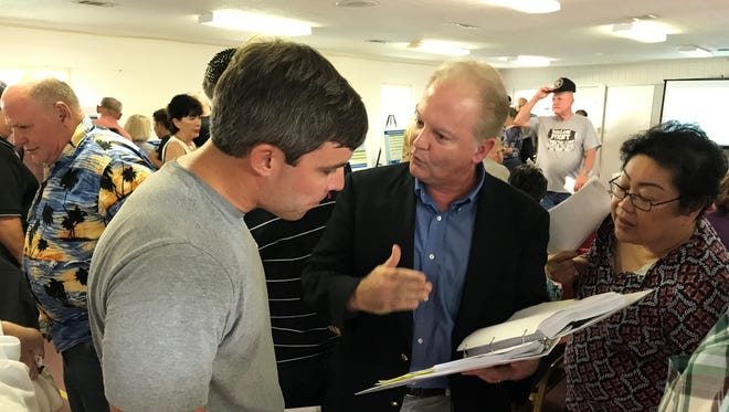 Commissioner Jeff Bergosh explains the Beulah Beltway project to Escambia County residents during a chaotic public meeting on Monday, Aug. 7, 2017, that had to be rescheduled.