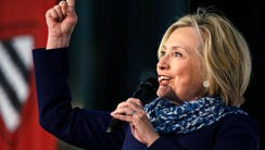 Hillary Clinton pumps her fist as she is introduced