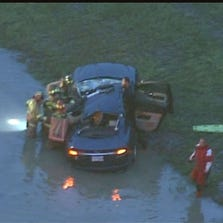 Several vehicles were involved in a wreck that sent three cars into water and shut down traffic on Westheimer Parkway in George Bush Park early Thursday.