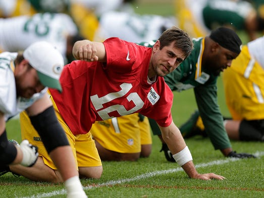 Green Bay Packers quarterback Aaron Rodgers stretches