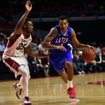 Louisiana Tech Bulldogs guard Xavian Stapleton (11) works against Temple Owls guard Quenton DeCosey at the Liacouras Center. Stapleton transferred to Mississippi State in July.
