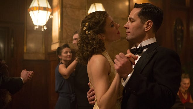 """Sienna Miller (left) and Paul Rudd (right) star in """"The Catcher Was a Spy."""""""