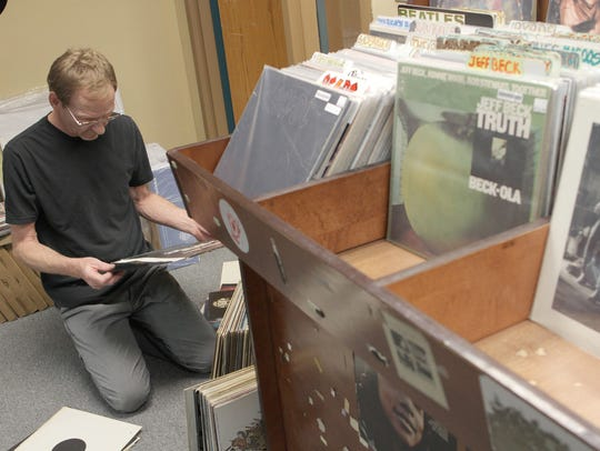 Record Collector owner Kirk Walther sorts through vinyls